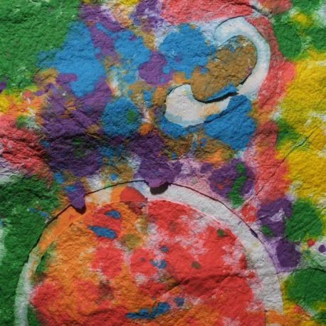 Pigment on recycled paper artwork with colors of green, blue, purple, red and orange melting together beneath a white circle moon