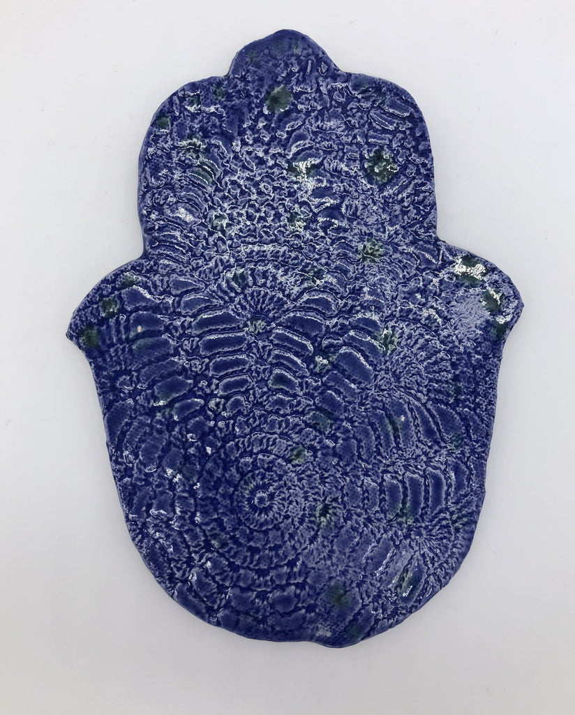 Bright blue hamsa hand with lace design.