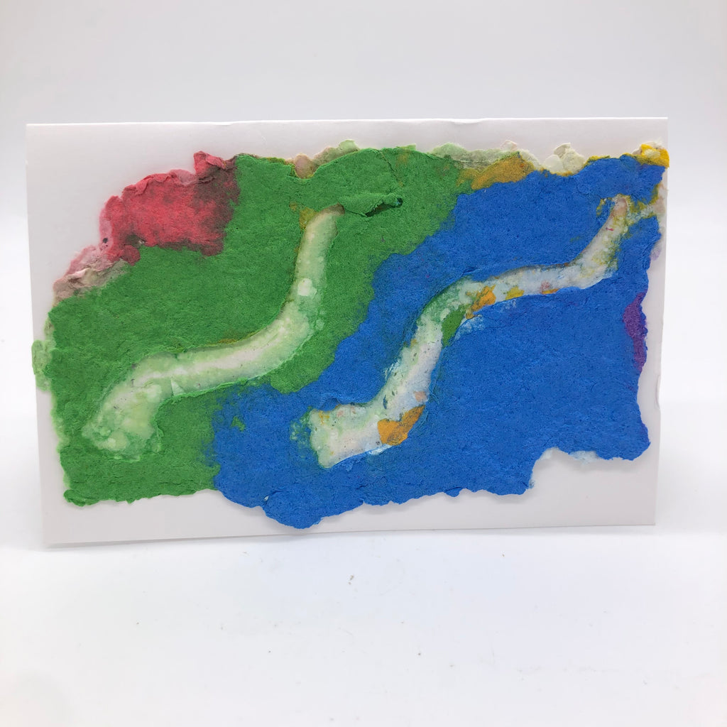 Handmade paper card with background in green and blue with a little pink..  Two white shofar are on top.