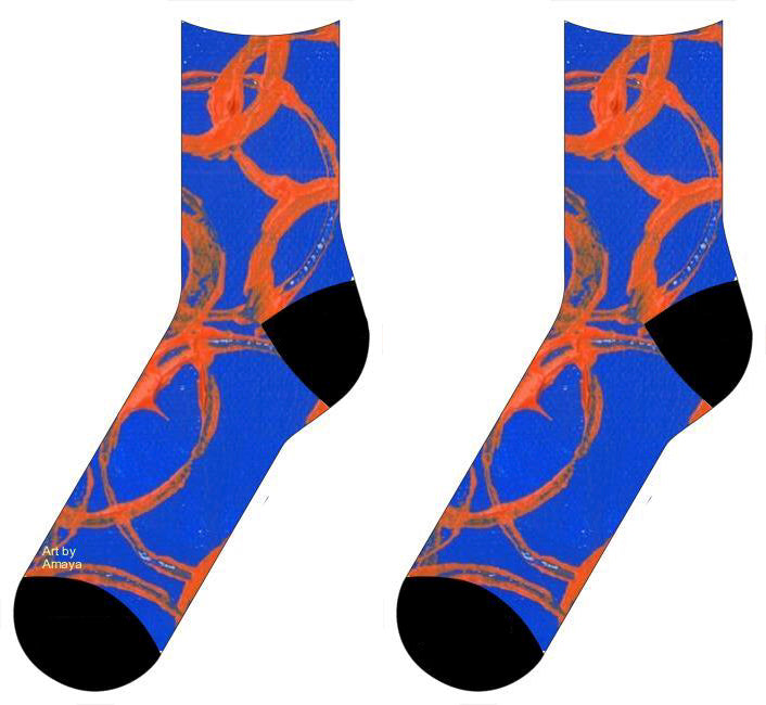 Royal blue socks with large orange overlapping rings