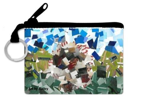 Front of Coin Purse designed with Collage made of square shaped cut photographs. In the center is a round object that is mostly white with hints of red lace. This ball is in the center of a field of two shades of green, lighter in the middle and darker near the bottom of the collage. The Sky is sparsely covered with different shades of blues.