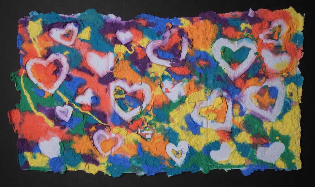 Highly textured handmade paper with various bright colors and embossed white hearts