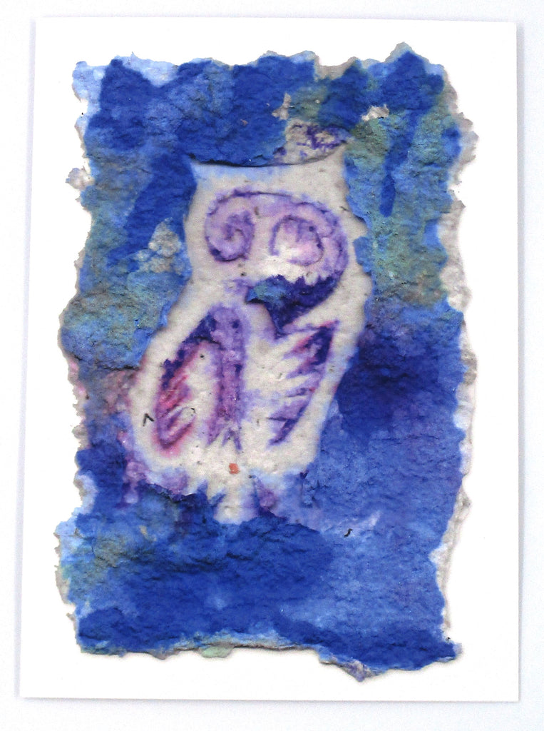 Graphic greeting card with a white owl against a blue background