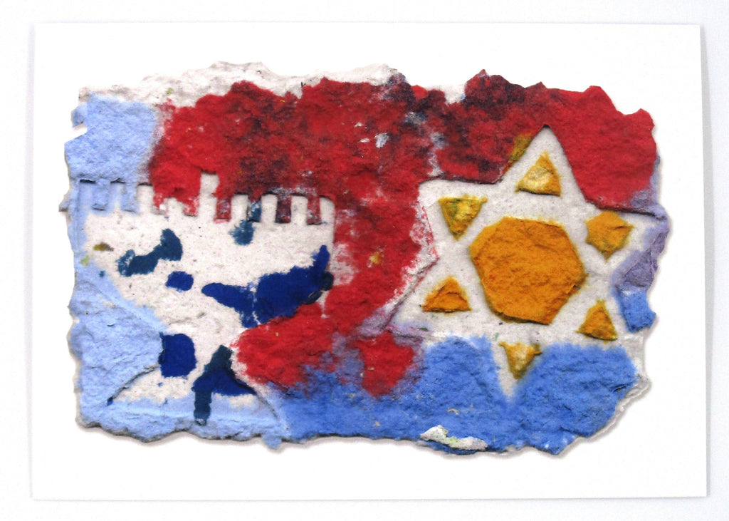 Printed card of handmade paper in shades of blue, red and orange.  Menorah and Star of David shapes, in white on top.