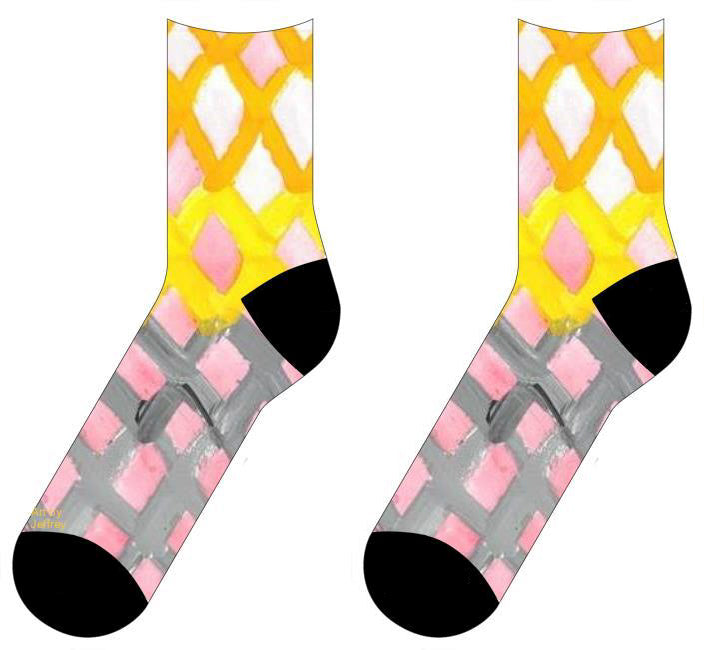 socks with a pattern of of lattice work. The three top rows yellow and the three rows underneath gray. In between the lattice is a light wash of red