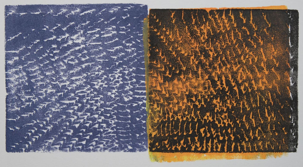 Ink on paper print with large indigo block with small white marks on the left and large black block with orange marks on the right