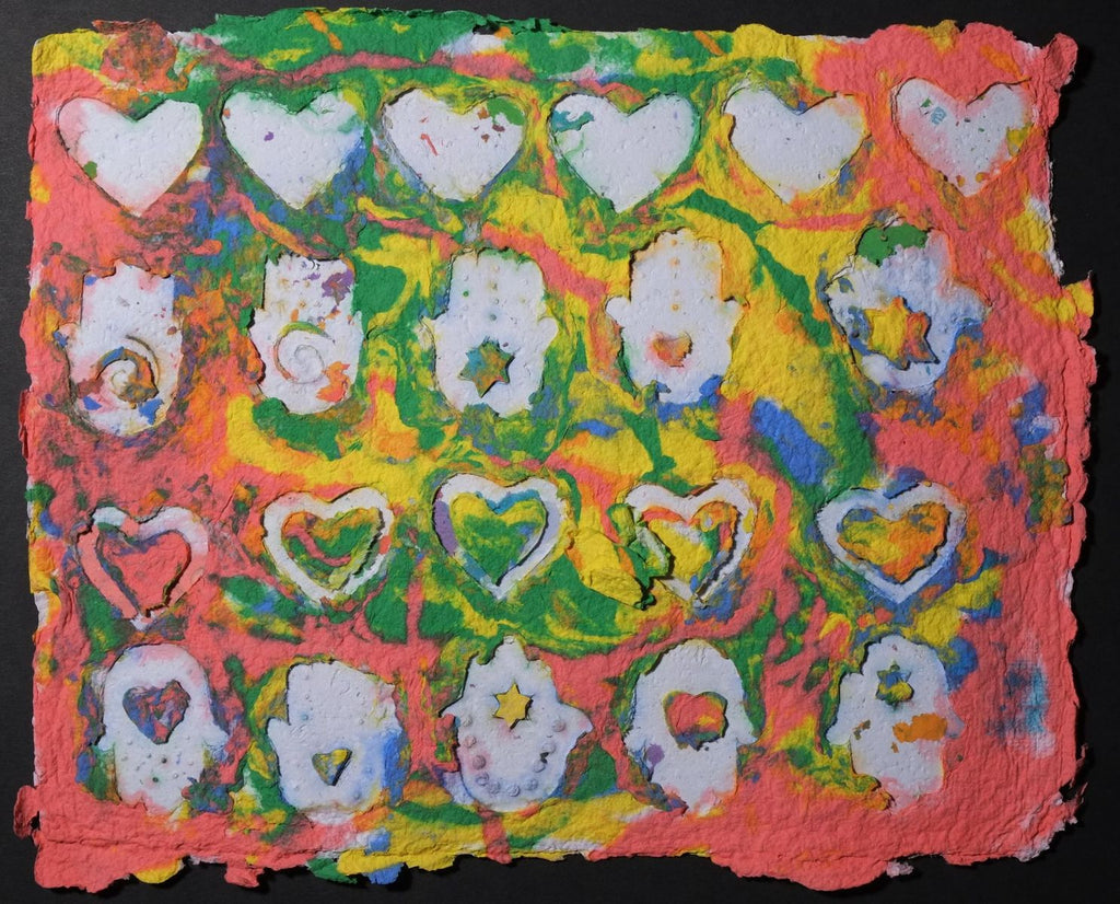 Pigment on recycled paper artwork with horizontal rows of white hearts and Hamsas against a background of coral, green, blue and yellow colors