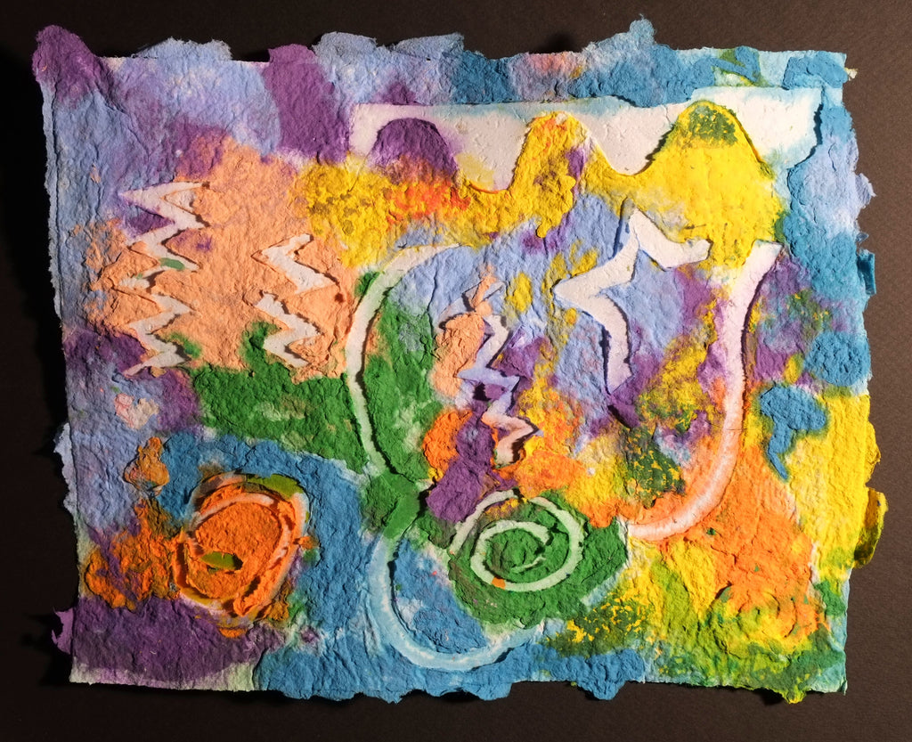 Pigment on recycled paper artwork with yellow, blue, purple, orange and green melted colors in the background with white shapes and swirls