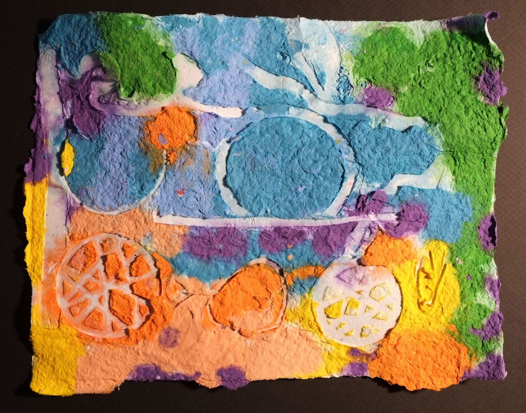Pigment on recycled paper artwork with blue, orange, green, and purple background and white circles overlaid