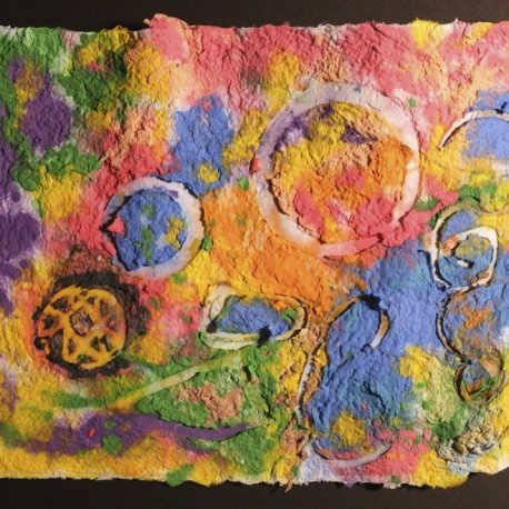 Pigment on recycled paper artwork with melted colors of green, purple, yellow, red, and blue beneath white circles and squiggles