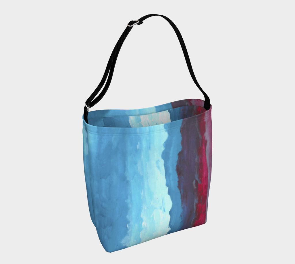Crossbody bag with red, light blue and dark blue gradient design