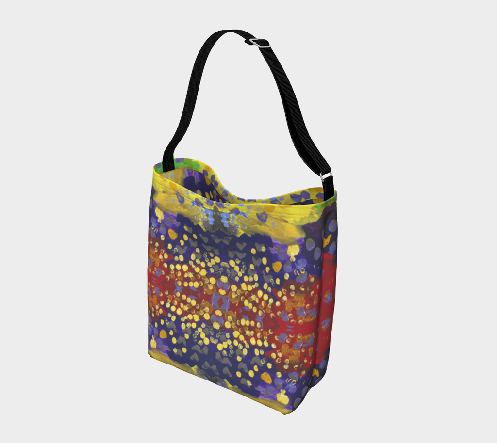 Crossbody tote with black strap with red, purple and yellow background with dots