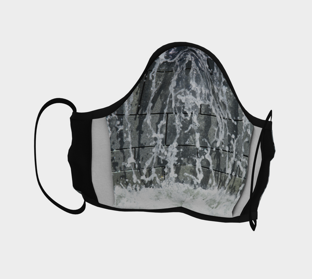 Front view of Face mask with gray, white and black design depicting running wate