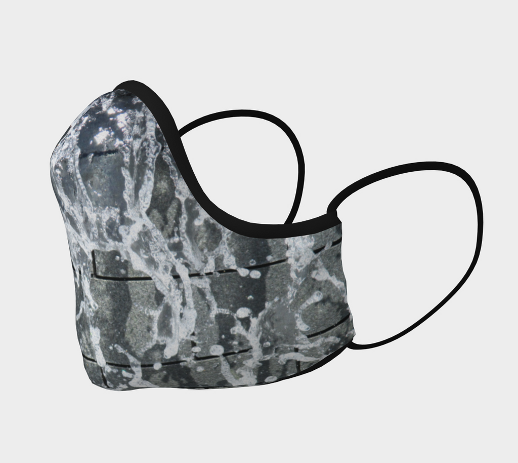 Side view of Face mask with gray, white and black design depicting running water