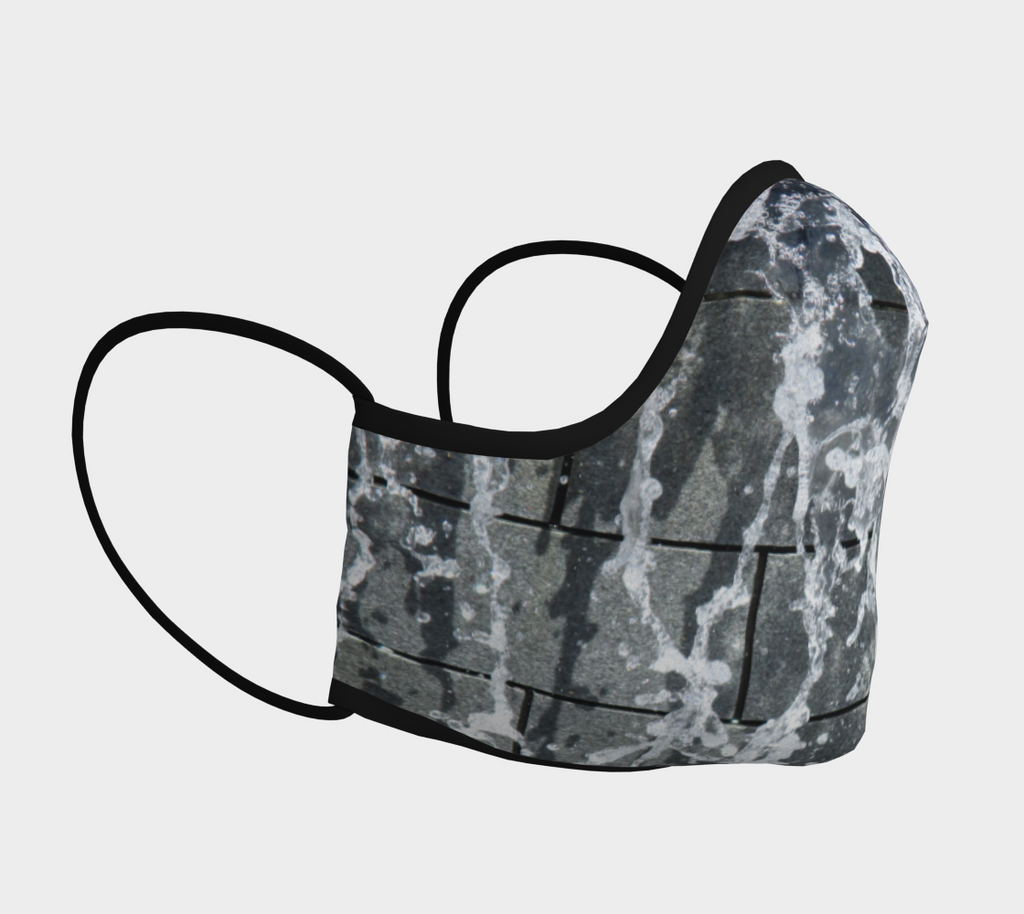 Side view of Face mask with gray, white and black design depicting running wate