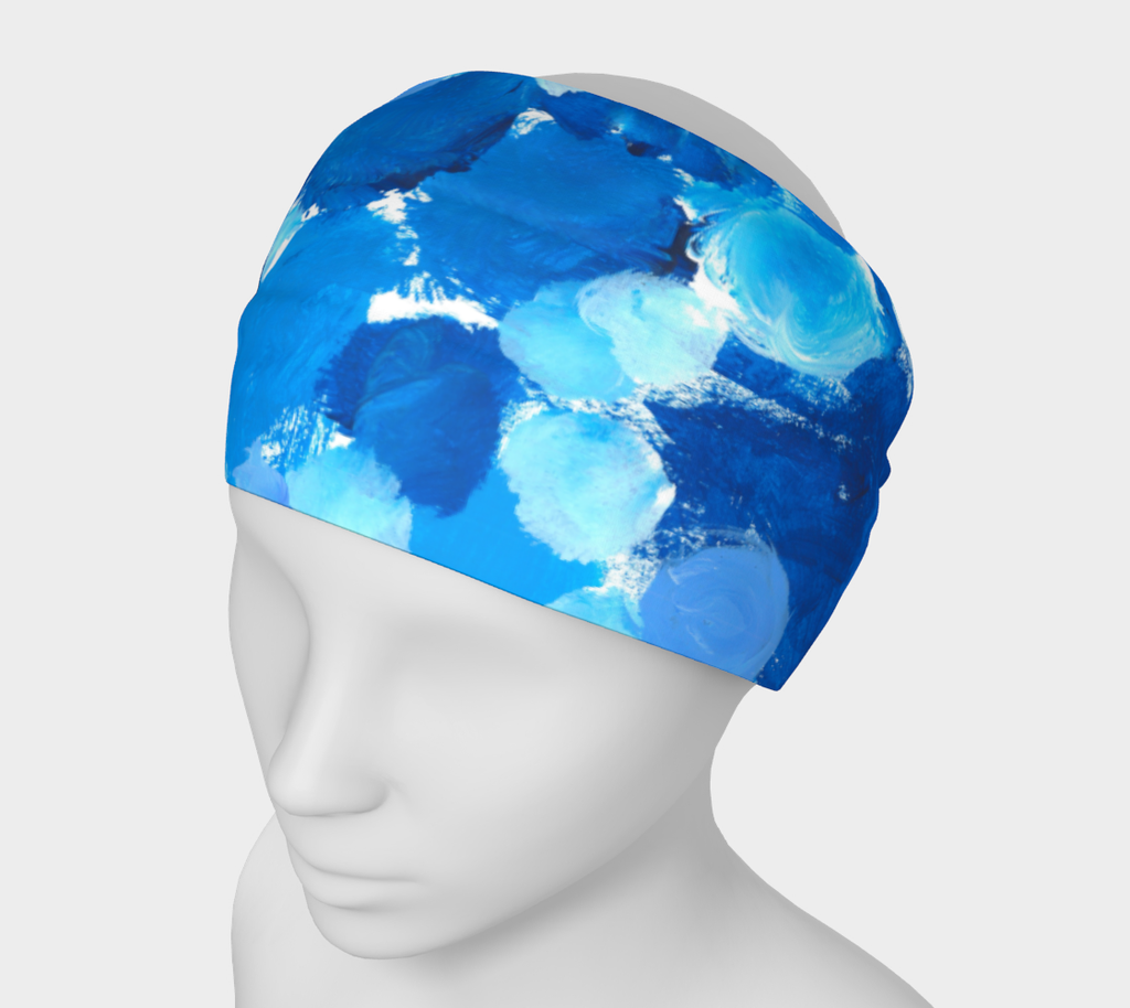 Manequin wearing headband. Designed with Splotches of light blue, medium blue, and dark blue on a white background give an impression of bubbles.