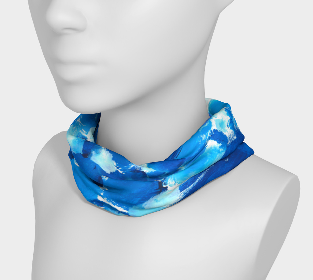 Headband shown wearing arounf neck, designed with Splotches of light blue, medium blue, and dark blue on a white background give an impression of bubbles.