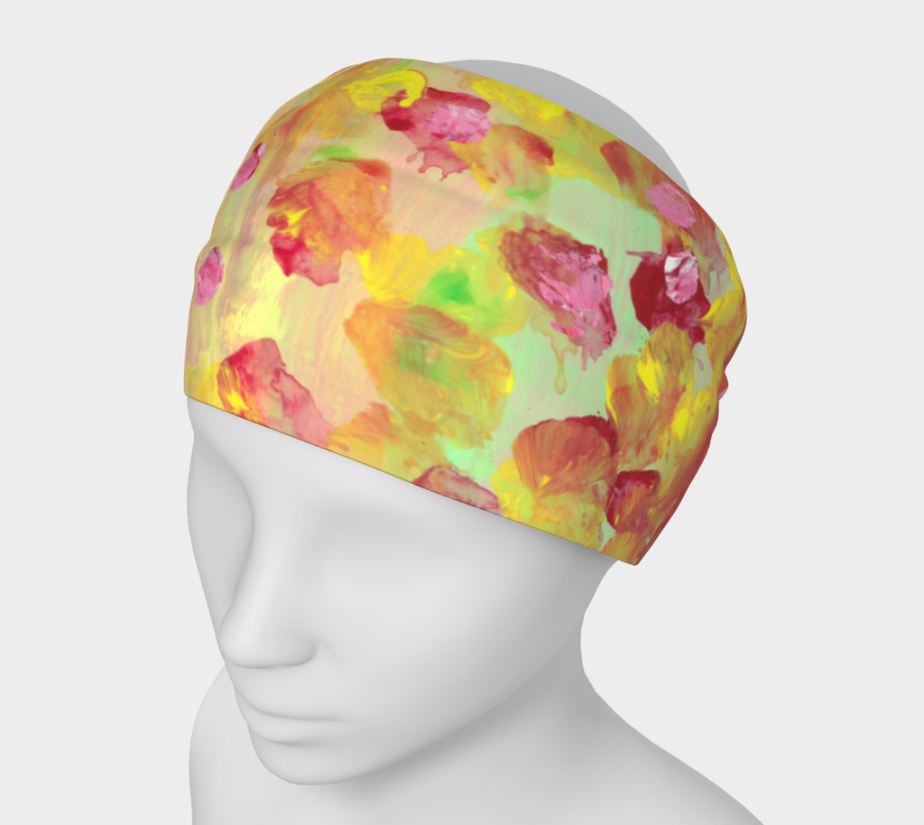 Mannequin wearing Headband with bright coral background with swatches of light green, yellow and red. Polka dots in yellow and red mixed