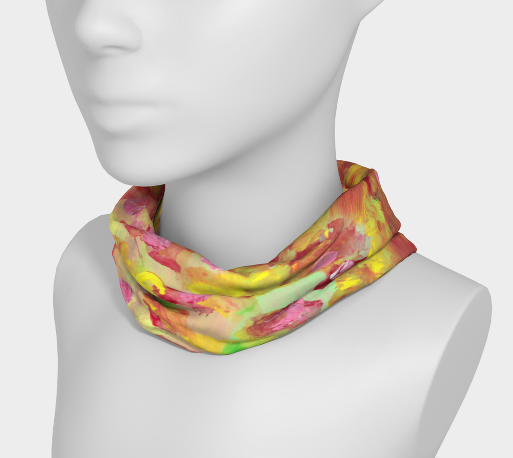 Mannequin wearing Headband around neck with bright coral background with swatches of light green, yellow and red. Polka dots in yellow and red mixed