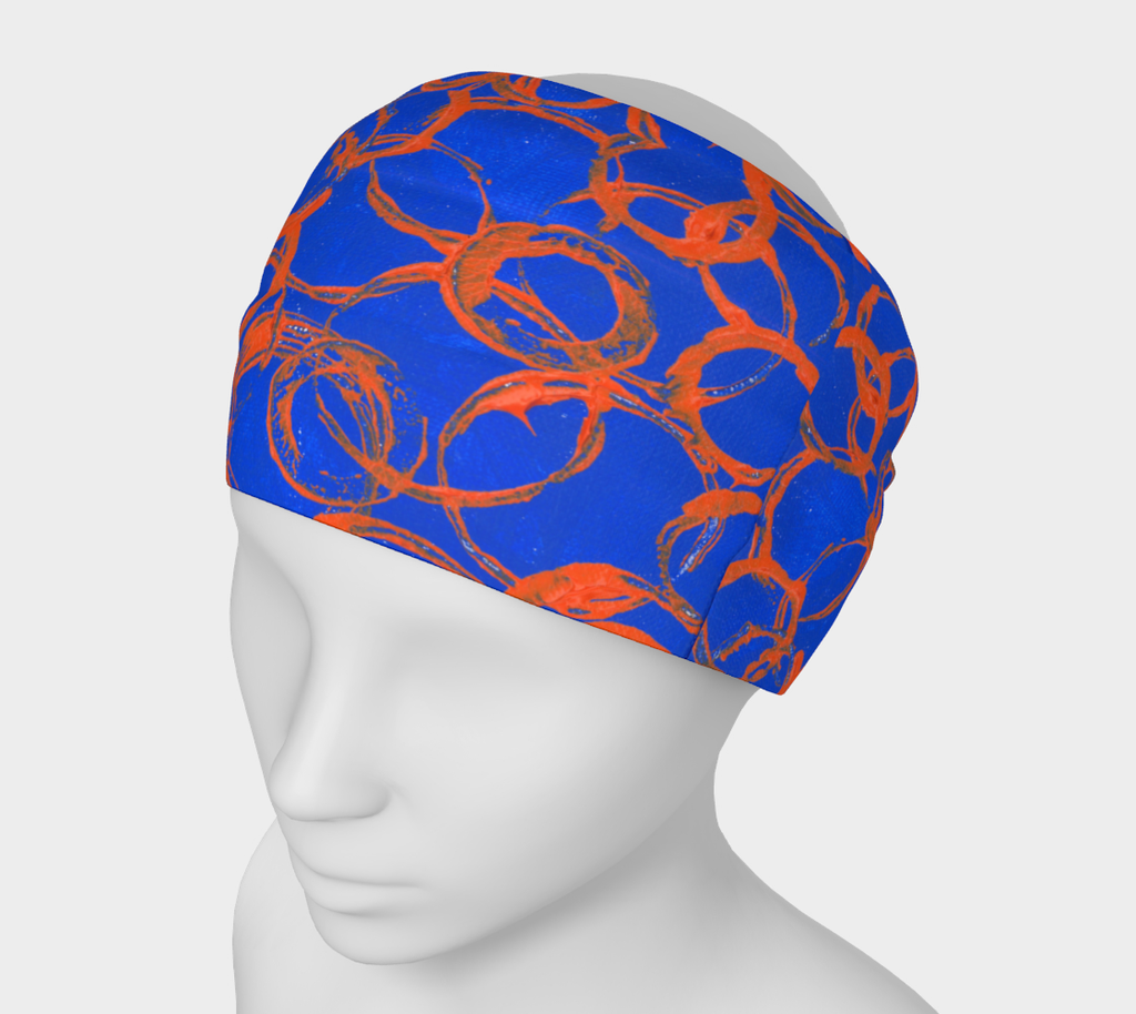 Mannequin wearing royal blue headband on with orange overlapping rings of various sizes
