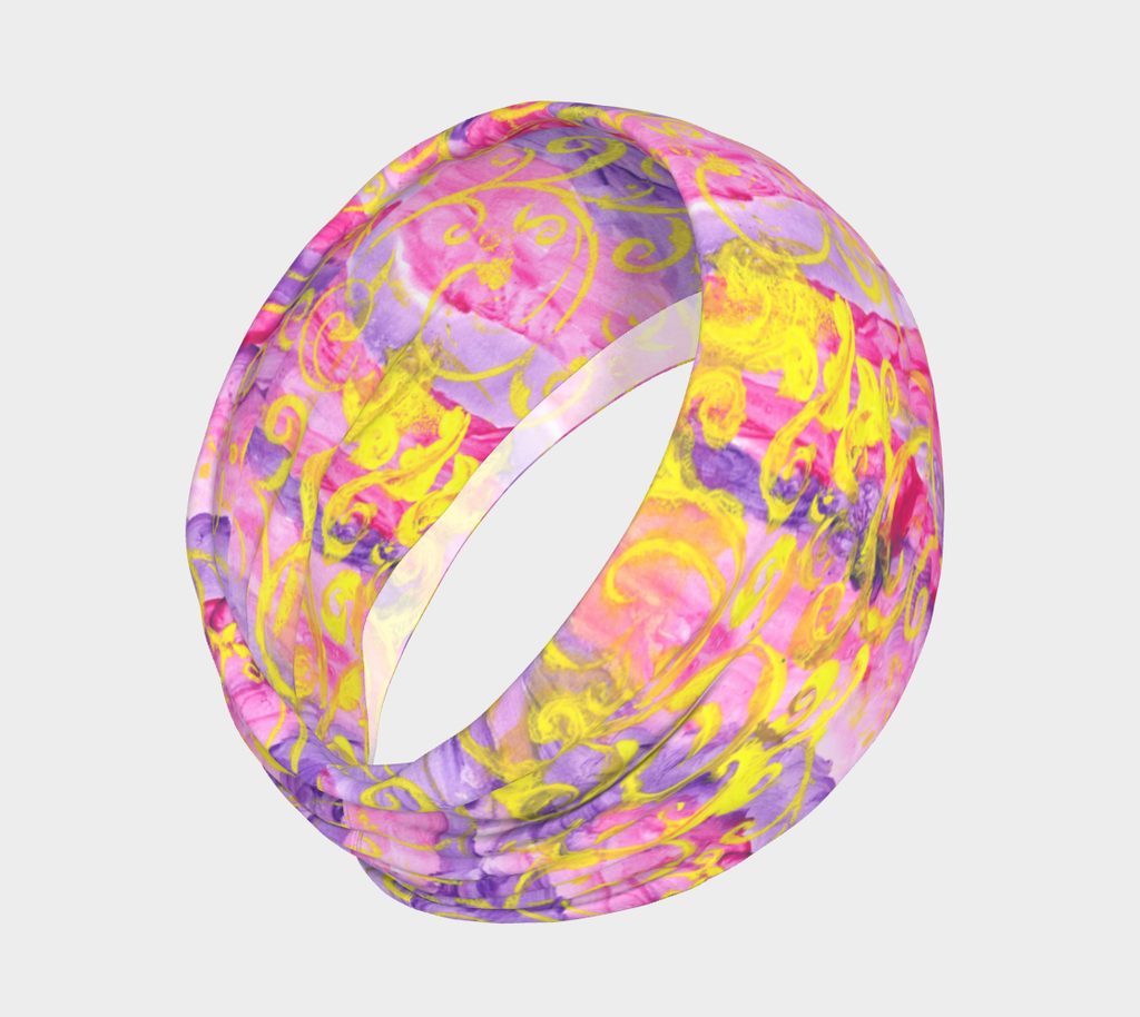 Headband with pink and purple stripes and yellow swirls all around.