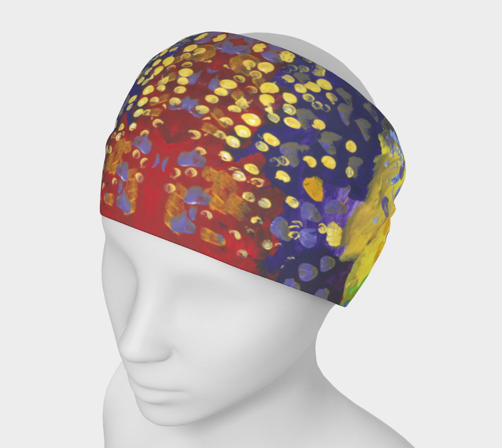 Mannequin wearing headband with red, purple and yellow background with dots