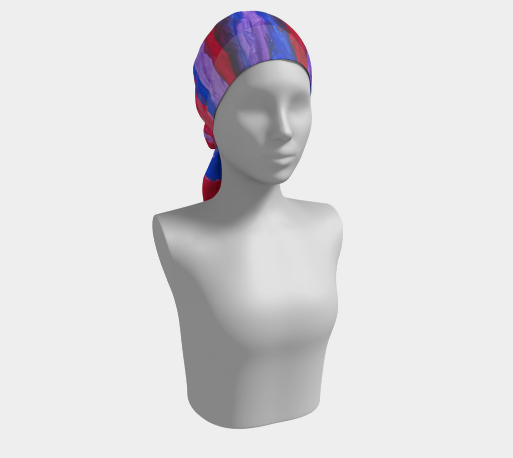 Mannequin wearing a royal blue, red and purple blended stripe scarf around head.
