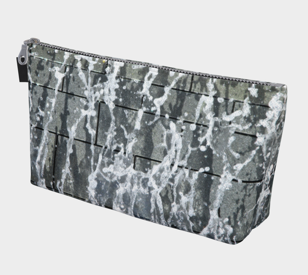 Makeup bag with gray, white and black design depicting running water