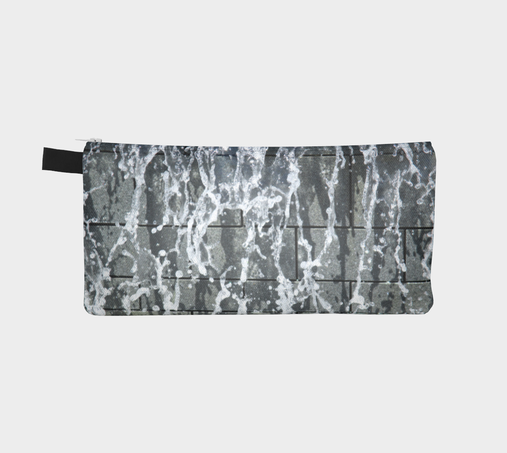 Zippered pencil case with gray, white and black design depicting running water