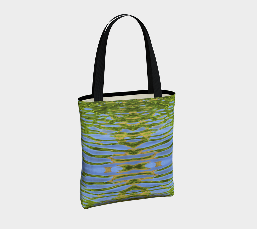 Canvas tote bag with black cotton straps. The pattern is of reflecting water and leaves