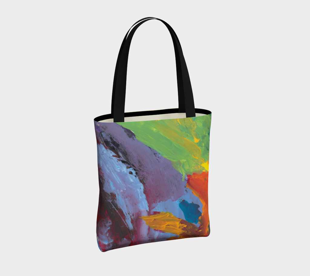 Crossbody tote bag with double black straps with lavender, light blue, green, yellow, orange and red paint streaks