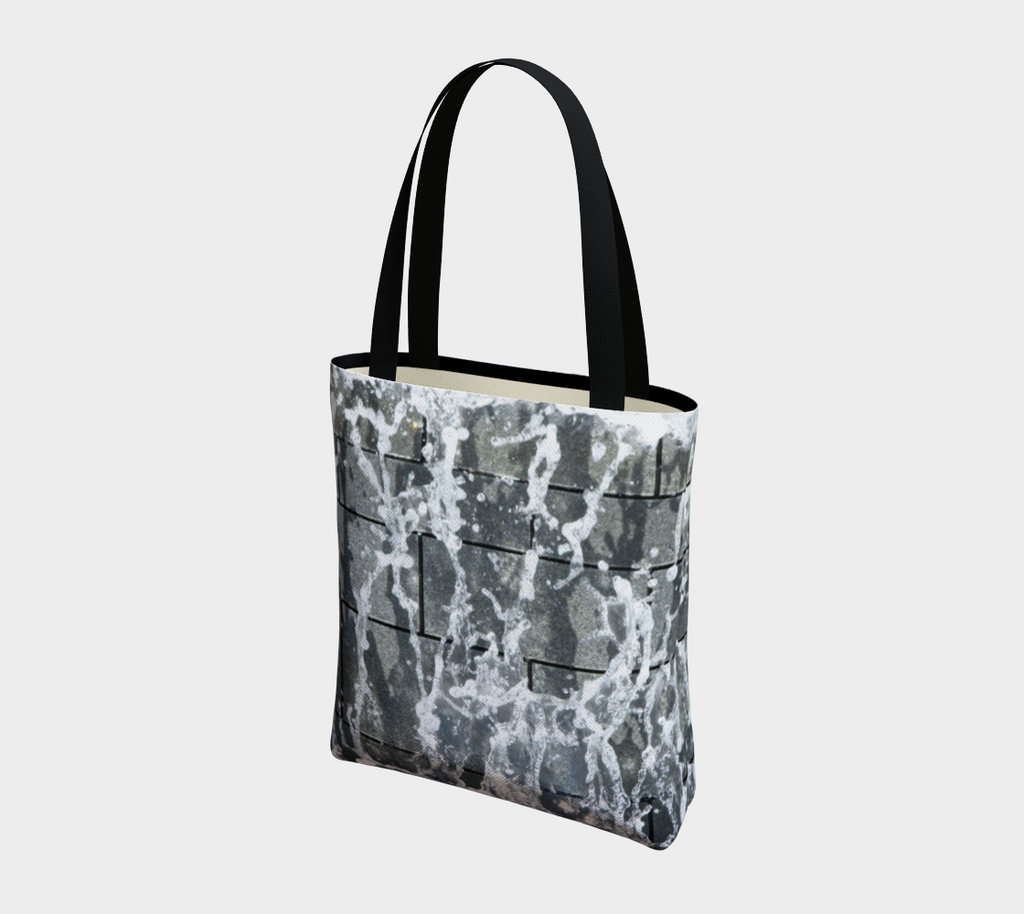Totebag with double black straps with gray, white and black design depicting running water