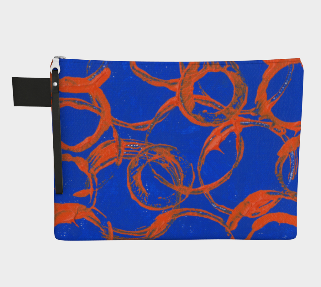 A royal blue carryall bag with orange large rings with handle strap.