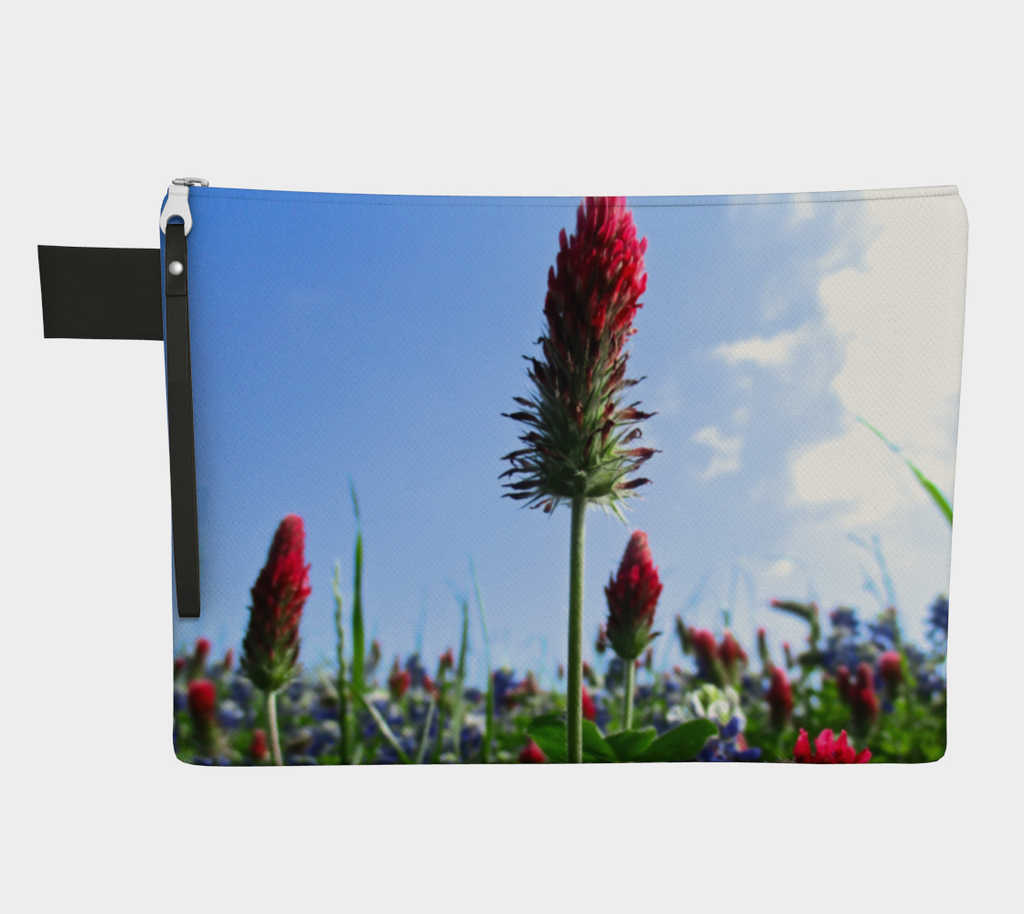 Zippered carryall bag with red Indian paintbrush flowers and bluebonnets in a green field