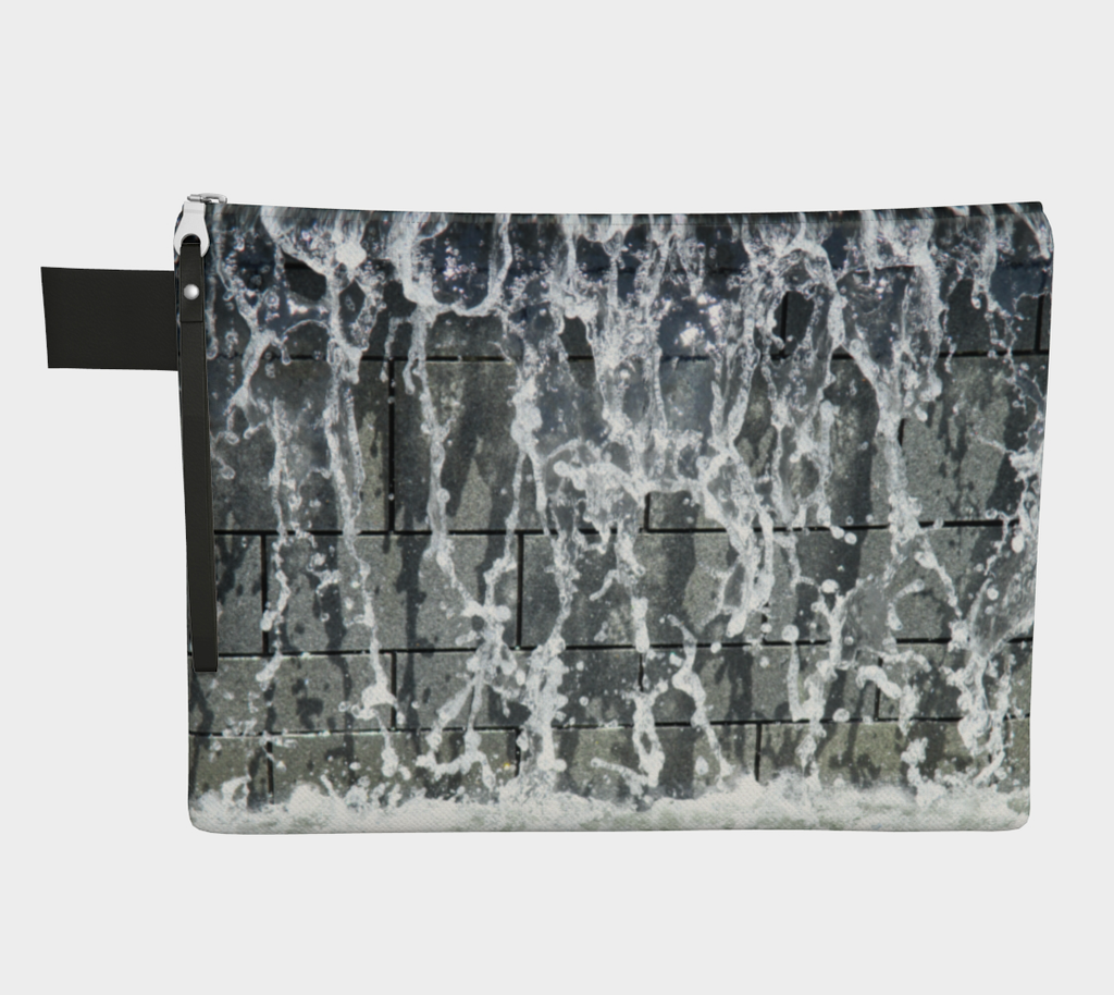 Zippered carryall with gray, white and black design depicting running water design