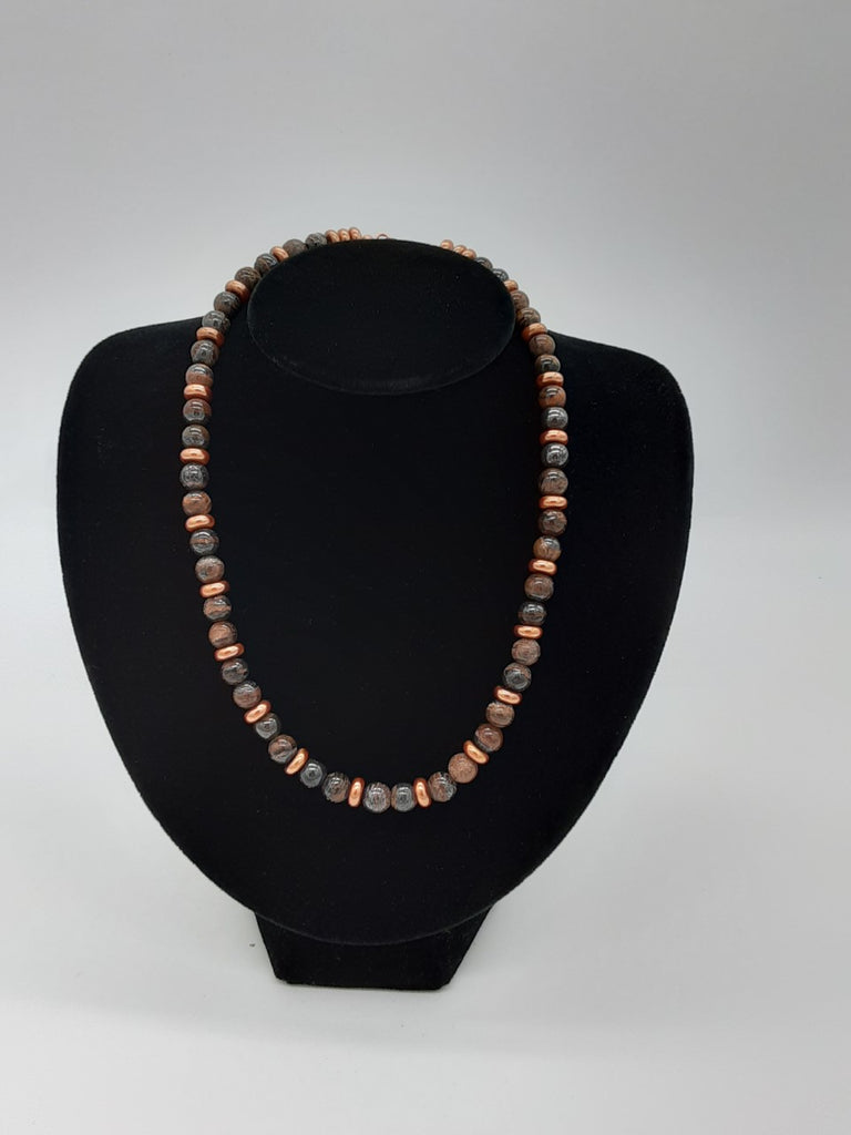 Necklace of semi precious brown stones and copper plastic disk beads