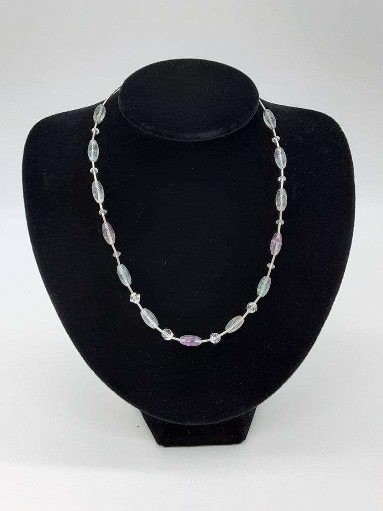 necklace os alternating metal cylinder beads with clear and slightly tinted oval beads in between