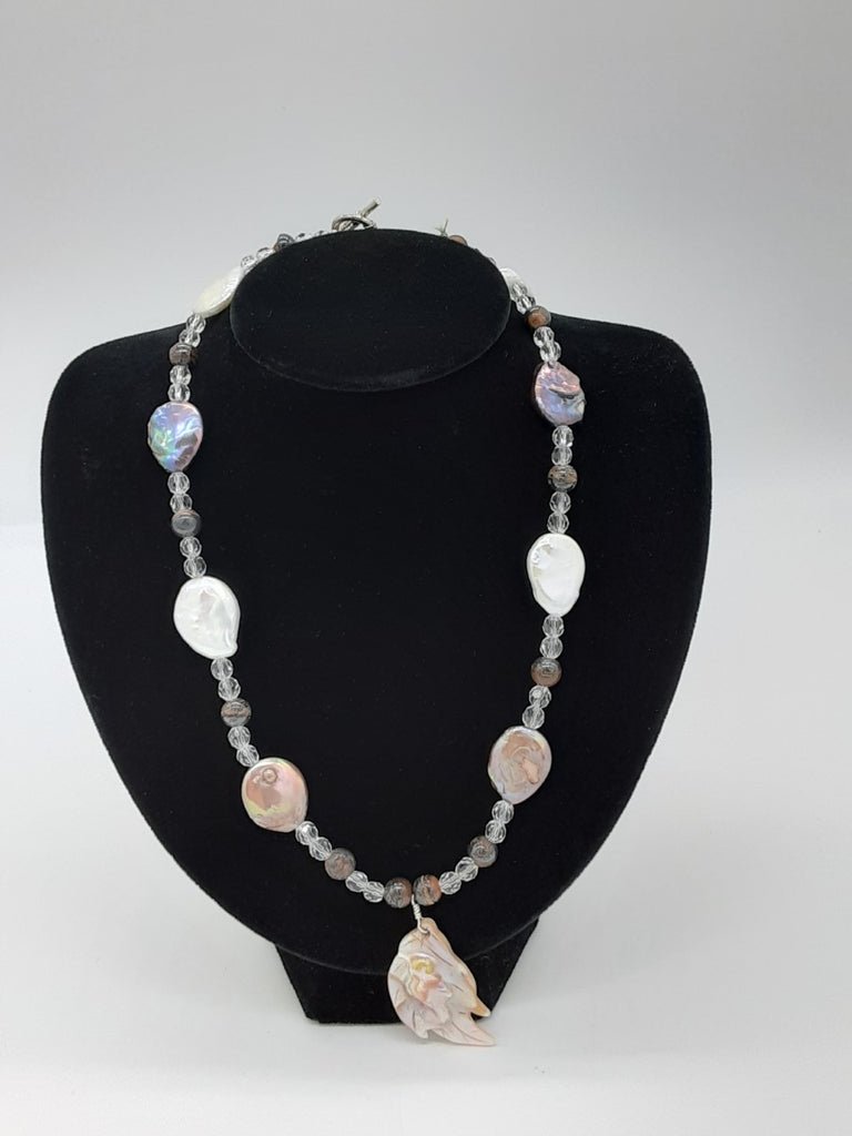 Necklace with irregular shaped pearls  and clear beads in between