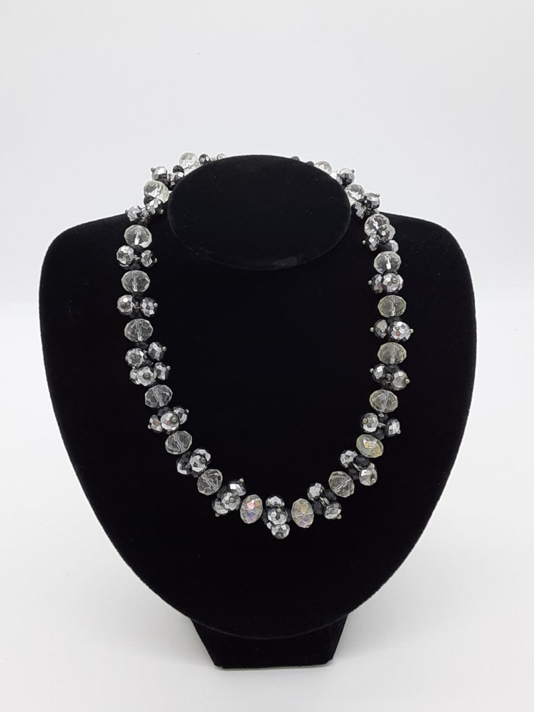 Necklace with clear, silver, and black faceted beads