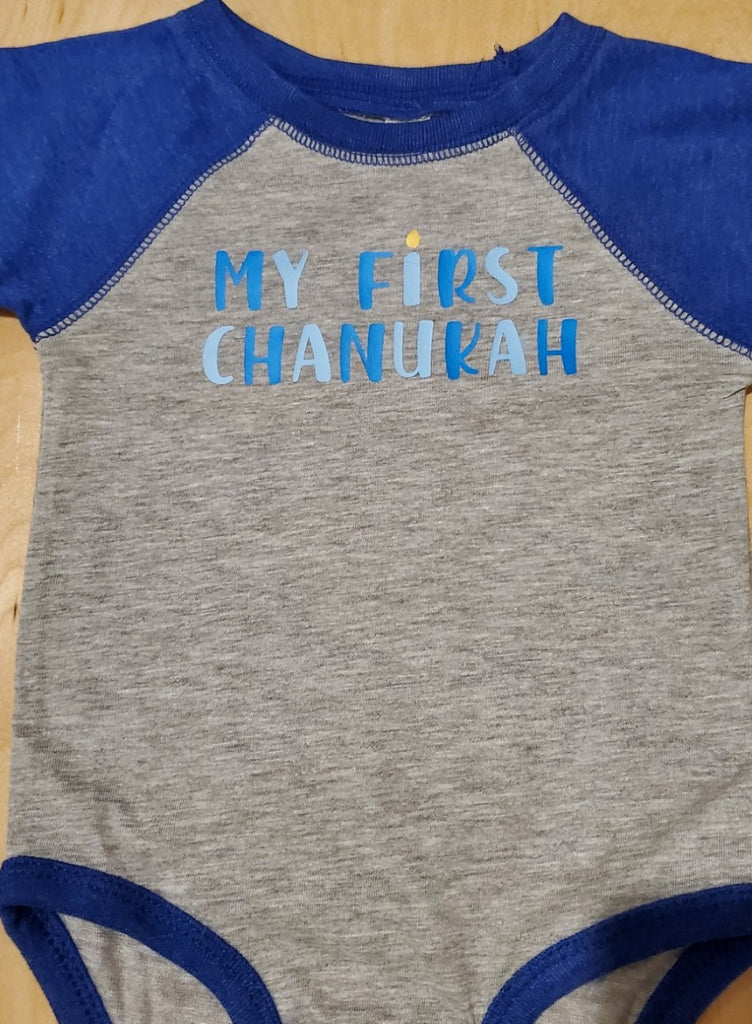 Gray onesie with blue sleeves and light and dark blue My First Chanukah slogan on the chest