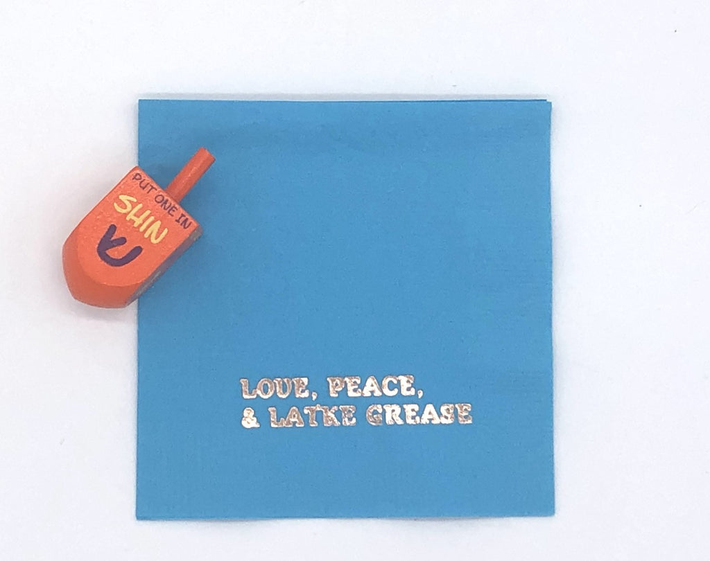 Light blue cocktail napkin with silver Love, Peace and Latke grease slogan