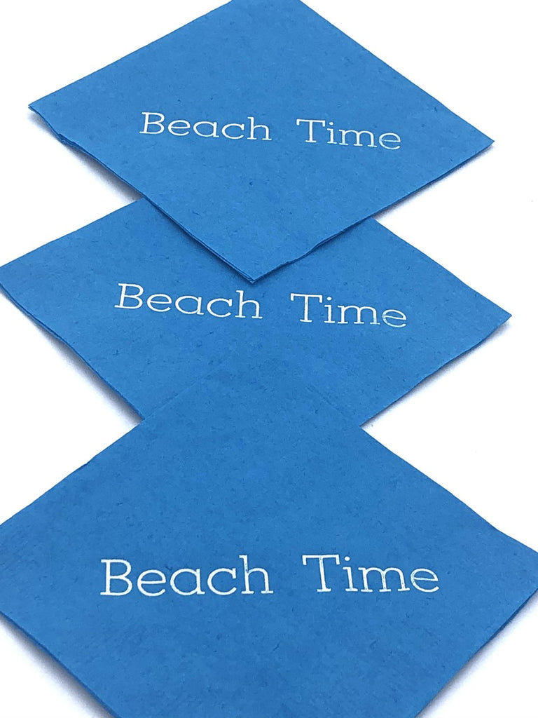 Light blue cocktail napkins with silver Beach Time slogan