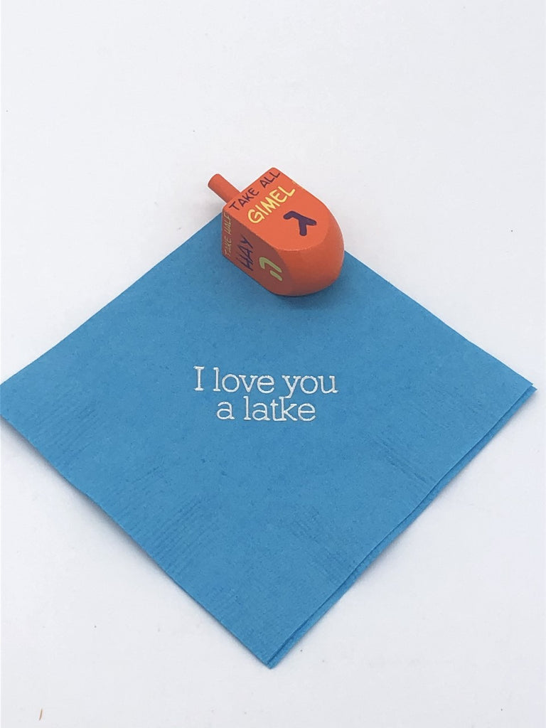 Light blue cocktail napkin with silver I love you a latke slogan