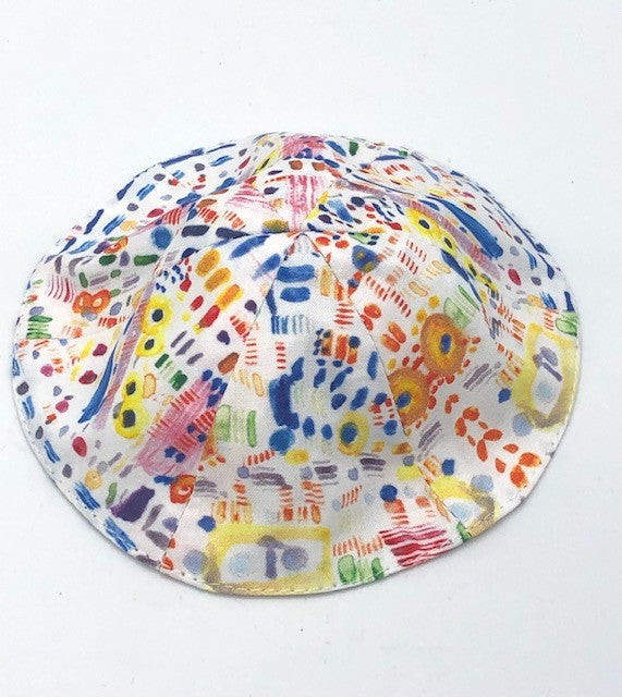 multi colored kippah on a white background