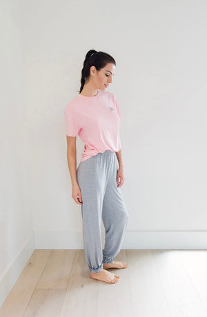 pink short sleeve t-shirt and grey thin pajama pants. Very soft sleep set made by privilage clothing from Vancouver Canada
