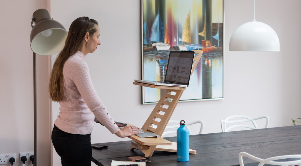 Woman using a standing desk