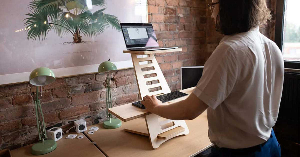 guy working at a standing desk