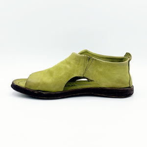 Inner side view of the as98 reiley flat sandal in a green detox color. The shoe in this image covers the foot in leather. The sides has small openings and the inner side has elastic. The shoe has an open toe.