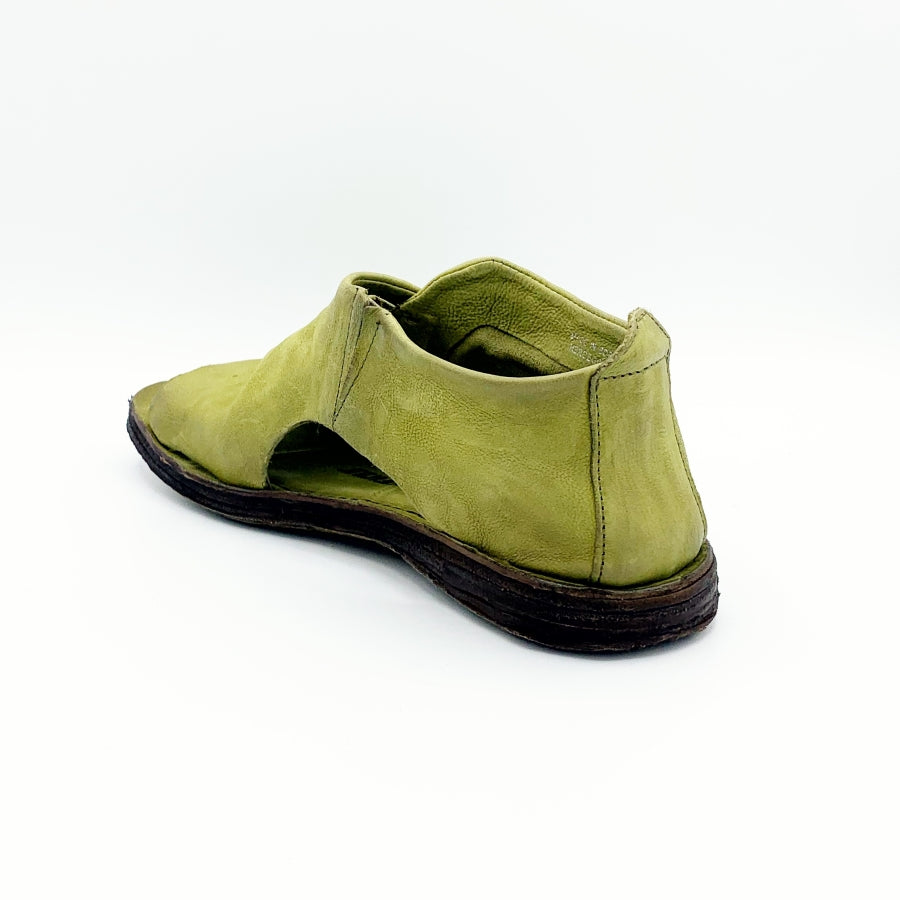 Back, Inner side view of the as98 reiley flat sandal in a green detox color. The shoe in this image covers the foot in leather. The sides has small openings and the inner side has elastic. The shoe has an open toe.