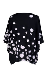 Load image into Gallery viewer, Back view of the alembika multi spotted lia jersey top. This top is black with different types of white spots all over it. The sleeves are 3/4 length and the shirt has an oversized fit.